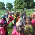 Happy young pupils in the schoolyard with planted trees