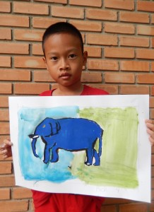 A young artist with his painting of a blue elephant