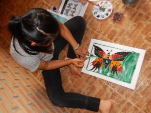 A young artist works on her butterfly study.