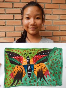 a young artist with her finished butterfly watercolor