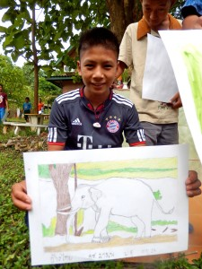 A young artist with his drawing of an elephent