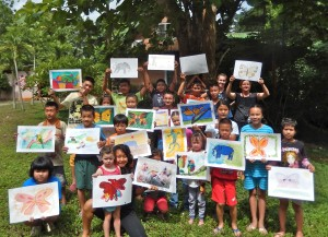 Young artists of Children's Shelter Foundation with their finished paintings.