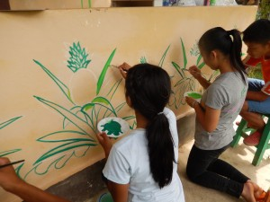 Young students at work on the mural.