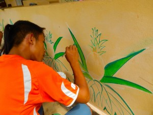 Young student at work on the mural.