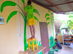 Making progress on the mural as the jungle garden grows on the walls.