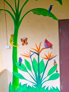 A section of the mural with geckos, birds, and butterflies.