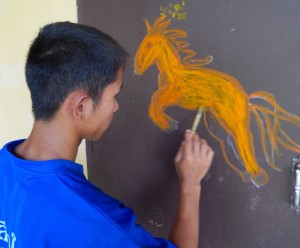 This young artist was so inspired he wanted to paint a horse on his door.  I promised to come back next year to extend the mural further.