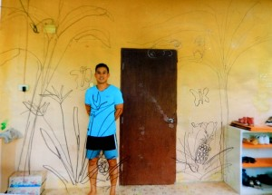 Khru Chey in front of  the dorm wall.  I used this photo to design the sketch for the mural.