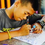 "Young Artist at Work (""Dream Stones"" Art Workshop with Children's Shelter Foundation. Chiang Mai, Thailand 2016)"