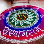 "A local ""Rangoli"" design of pigmented rice flour greets us."